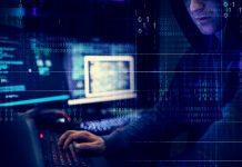 hacker-working-using-computer-with-codes-PFX24VK