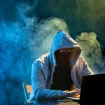 hooded-computer-hacker-stealing-information