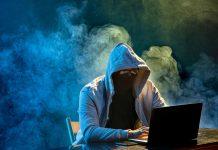 hooded-computer-hacker-stealing-information